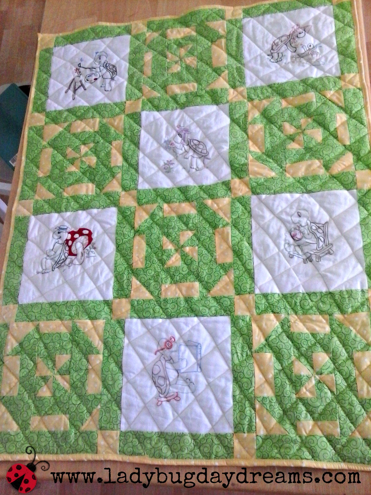 Embroidered turtle quilt with pieced blocks