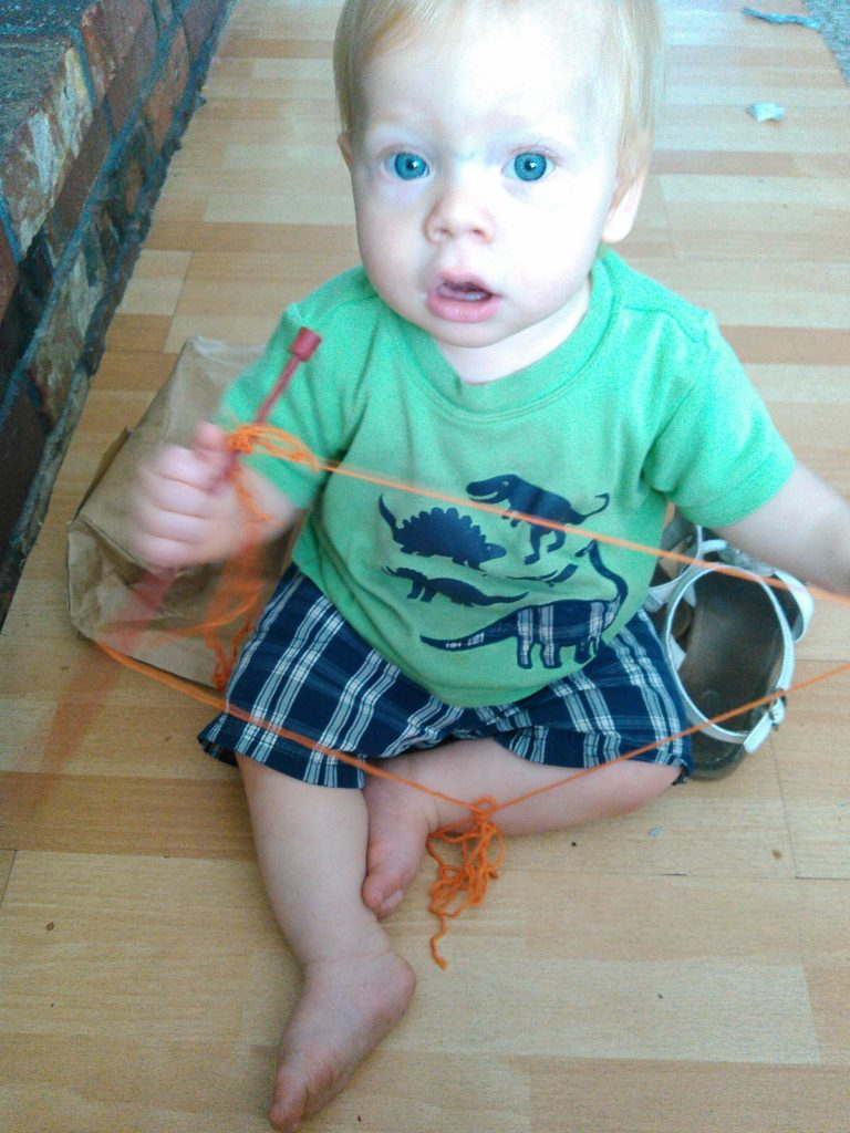 "This is what Dragonfly was doing while everyone else was away for the day: ""learning to knit."" :)"