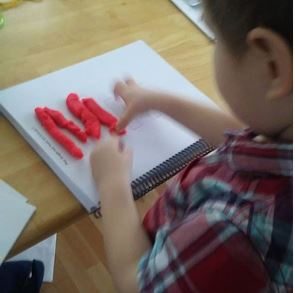 Filling in the letter M/m with Play-Doh.