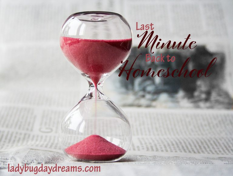 an hourglass with red sand sitting on top of an open newspaper