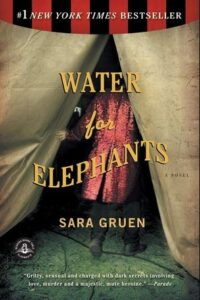 """the official """"water for elephants"""" book cover. a man is walking into a circus tent, and the title of the book is overlaid atop the image."""